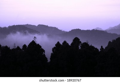 Early morning mist over the mountains of the Alishan area in southern Taiwan