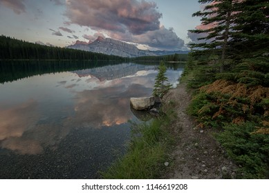 Early morning mountain reflection on Two Jack Lake in Banff National Park.