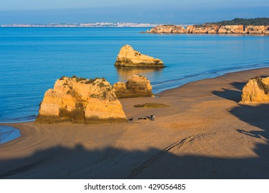 Early morning on the beach of Praia da Rocha, Portimao Coast. Algarve region. Portugal