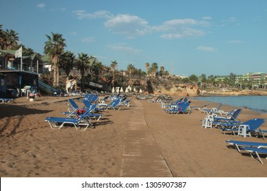 Early morning on a great beach, sun loungers installed, clean sea water, warm sand, many places