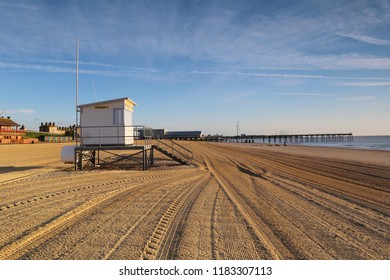 Early morning on Lowestoft beach in Suffolk, England showing the lifeguard hut
