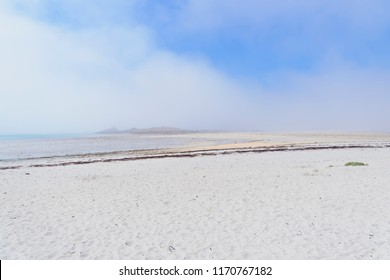 Early morning on the Plage Sainte-Marguerite and the sea mist swilrs around the small islands