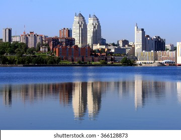 Early morning on the river Dnieper , buildings reflected in the water , Dnepropetrovsk , Dnipropetrovsk, Dnepr city, Dnipro, Ukraine .