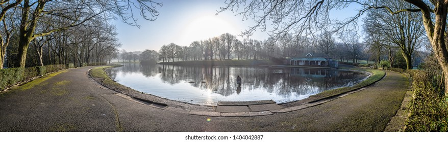 Early morning panoramic view of the boating lake at Queens park Blackburn Lancashire