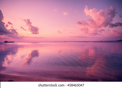 Early morning, pink sunrise over sea