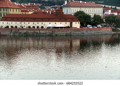 Early morning in Prague as seen from the medieval Charles Bridge  on Vltava River in  Prague, Czech Republic