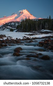 The early morning red light glowing on Mt. Hood mid December with a fair amount of snow around White River.