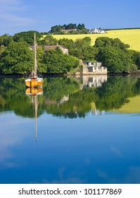 Early Morning Reflections of Boat and Boathouse, Salcombe, Devon, England
