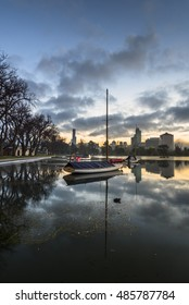 early morning reflections city skyline park lake yacht mooring Melbourne