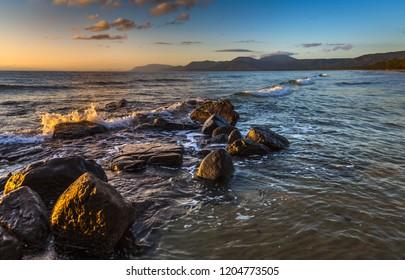 early morning reflections rocky tropical beach Port Douglas coastal Coral sea Daintree ocean waves sunny