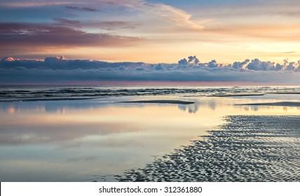 Early morning at sandy beach of the Riga gulf, Jurmala, Latvia