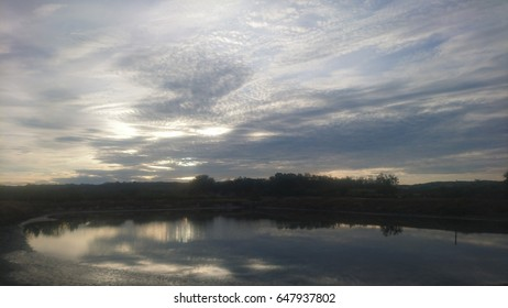 Early morning scenery of clouds reflected on a lake