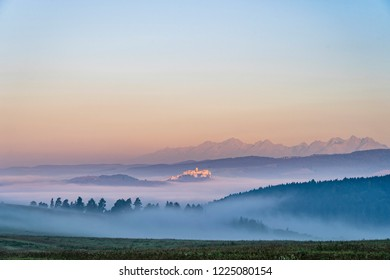 Early morning shot of Spis Castle surrounded with morning fog/mist in autumn time.