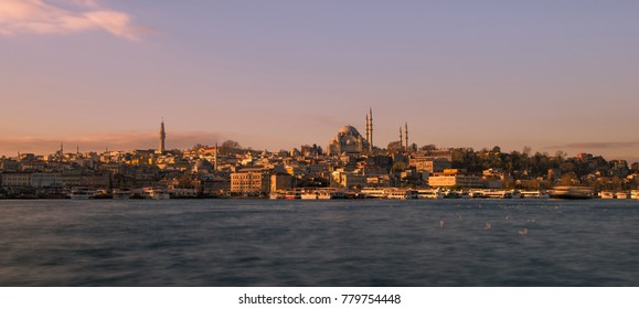 Early morning shot taken from Karaköy and Golden Horn waterway showing part of Istanbul, Turkey cityscape with the Süleymaniye Mosque being the major visible structure