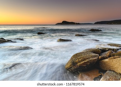 Early Morning Slow and Rocky Seascape - North Pearl Beach on the Central Coast, NSW, Australia.