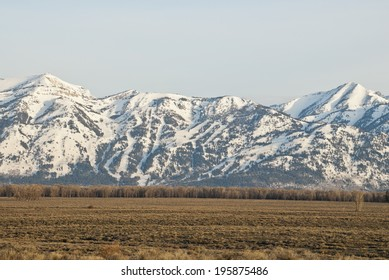 The early morning Spring light bathes the Teton Village Ski resort near Jackson Hole, Wyoming.