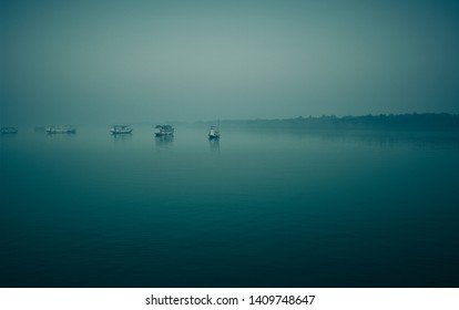 Early morning in Sundarbans delta, West Bengal. Few boats/ tourist vessel standing in the middle of river.