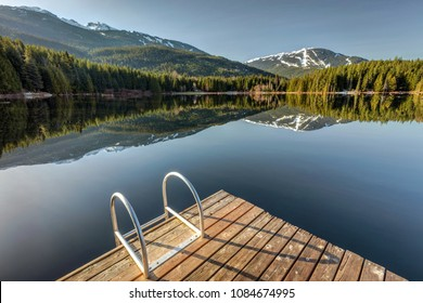Early morning sunlight on the dock at Lost Lake in Whistler, British Columbia, Canada
