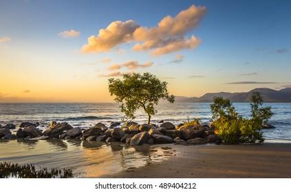 early morning sunrise 4 mile beach tropical beach Port Douglas Queensland