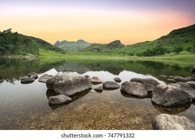 An early morning sunrise at Blea Tarn in the Unesco World Heritage Lake District