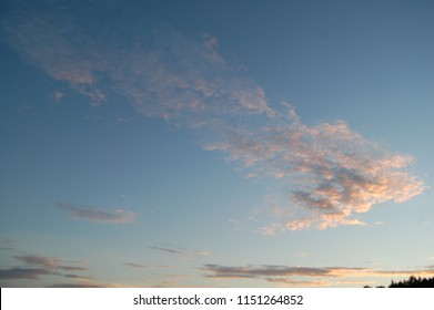 Early Morning Sunrise with Blue Sky and Pink Clouds