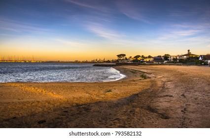 early morning sunrise city skyline beach Brighton Melbourne bay marina yachts clear calm sunny day
