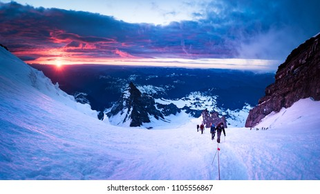 Early morning sunrise as climbers attempt to summit Mt Rainier in Washington