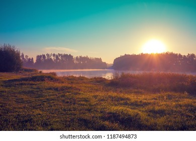 Early morning, sunrise over lake. Rural landscape, wilderness.