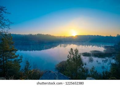 Early morning, sunrise over lake. Rural landscape, wilderness.
