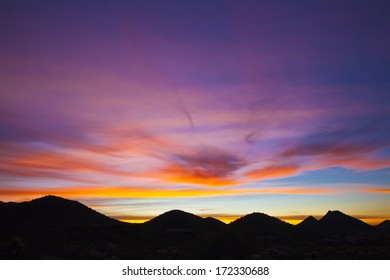 An early morning sunrise over the mountains in Arizona