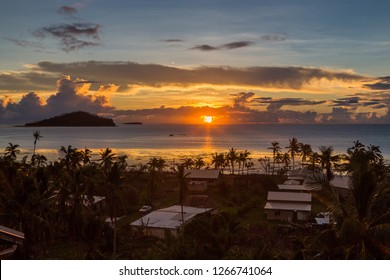 Early morning and sunrise over Pacific Ocean in Mata-Utu village, the capital of Wallis and Futuna territory (Wallis et Futuna), French overseas island collectivity. Downtown is overgrown with palms.