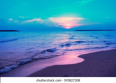 Early morning, sunrise over sea. Blue pink beautiful sunrise. Twilight time on the beach. Wild nature.