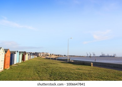 early morning sunrise showing beach and beach huts at harwich, uk