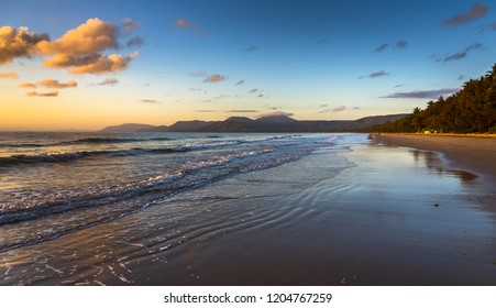 early morning sunrise tropical Port Douglas beach reflections Coral sea barrier reef Queensland Daintree