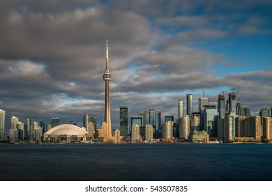 The early morning sunshine casts its glow over the skyline of Toronto, Canada.