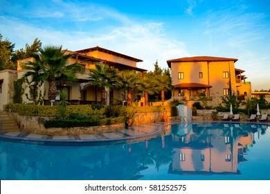 Early morning. Swimming pool at hotel Greek Aegean Melathron, Greece - September 2013.