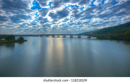 Early Morning Twin Rivers Bridge Looking East with Puffy White Clouds Over The Arkansas River.
