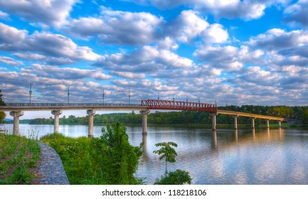 Early Morning Twin Rivers Pedestrian Bridge with Puffy White Clouds Over The Arkansas River.