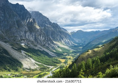 Early morning in Val Ferret valley in Italy, with overcast sky and rocky mountain range