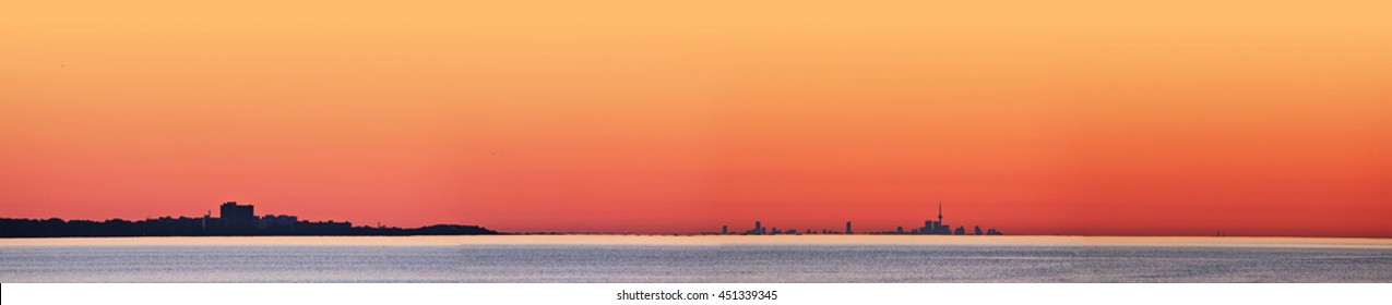 Early morning view from the Burlington Canal Pier South Outer with the shoreline from Burlington to Toronto in the distance.
