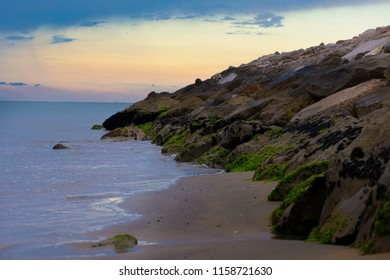 Early morning view of an empty beach with rocks in Bibione, a town on the Adriatic Sea