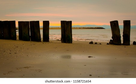 Early morning view of an empty beach with peers in Bibione, a town on the Adriatic Sea