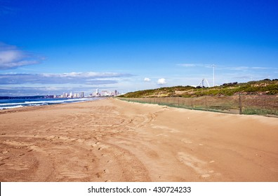 Early morning view of empty beach against city skyline in Durban South Africa