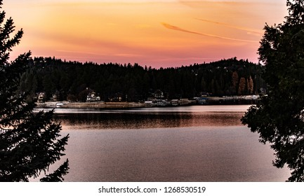 Early  morning view of Lake Arrowhead, California in the winter with beautiful sky, water reflections, trees, and many colors