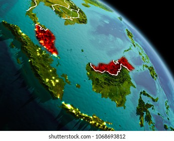 Early morning view of Malaysia highlighted in red on planet Earth with visible border lines and city lights. 3D illustration. Elements of this image furnished by NASA.