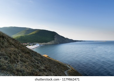 Early morning. The view from the mountain with grass on the beach in the village of Sukko. Suburb of Anapa, Krasnodar region.