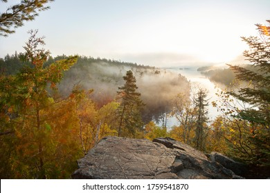 Early morning view of a northern Minnesota lake with mist during autumn