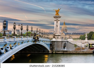 Early morning view on the famous landmark Alexander iii bridge in Paris, capital of France, with beautiful clouds in the sky and the golden statue catching the first sunrays