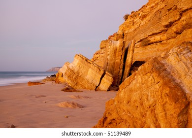 Early morning view of the sandstone rocks near the fishing village of Salema , Portugal