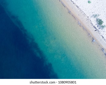 Early morning views top down perspective showing the lovely pristine aqua blue water of Ettalong beach Australia